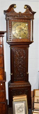 Lot 1086 - A carved oak thirty hour longcase clock, the square brass dial signed Ewbank, Elland