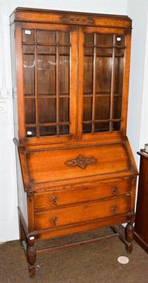 Lot 1088 - A 1920s oak bureau bookcase, 90cm by 44cm by 194cm