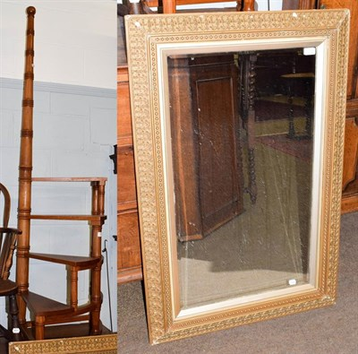 Lot 1092 - A set of reproduction library steps, 183cm high, together with a gilt framed mirror (2)