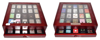 Lot 6 - ~ Two collectors display cases each containing forty Zippo lighters over two layers, US Navy,...