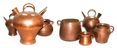 Lot 7 - ~ A collection of antique copper vessels probably South American, including flagons and twin...