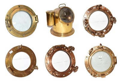 Lot 11 - ~ Five brass ships portholes, two with glass, together with a brass cased marine compass on...