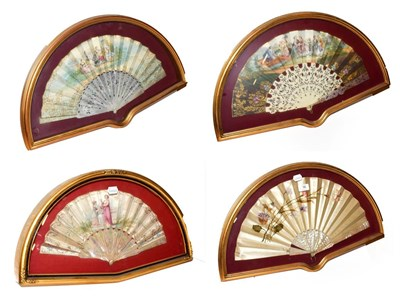Lot 16 - ~ Four fans each in a gilt framed wall hanging display case, including a silk example...