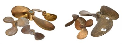 Lot 18 - ~ A quantity of brass two and three blade boat propellers, largest 40cm wide (7)