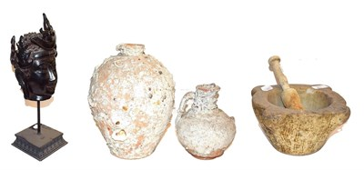 Lot 19 - ~ A white marble mortar with wooden pestle, two shipwrecked terracotta vessels and a composite...