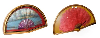 Lot 21 - ~ Two fans in gilt framed wall hanging display cases, one faux tortoiseshell and ostrich...