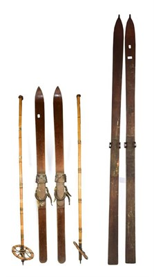 Lot 25 - ~ Two pairs of vintage wooden skis and a pair of bamboo poles (6)