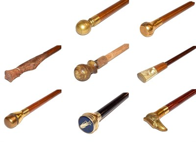 Lot 34 - ~ A quantity of walking canes with brass toppers etc (8)