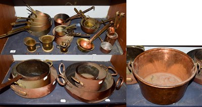 Lot 35 - ~ A collection of mainly antique brass and copper cooking wares, including graduated pans and...
