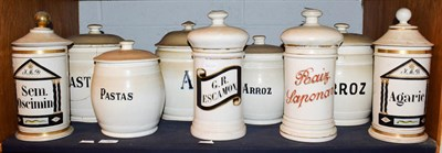 Lot 37 - ~ A quantity of Spanish pottery food storage jars and covers with enamel and gilt lettering (1...