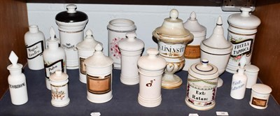 Lot 38 - ~ A quantity of Spanish pottery and opaque glass apothecary jars and other storage vessels and...
