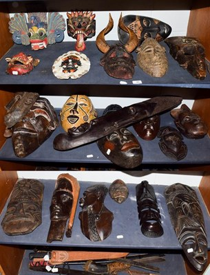 Lot 40 - ~ A quantity of souvenir tribal masks from Africa and Malaysia (on 3 shelves)
