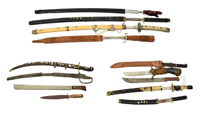 Lot 41 - ~ Three machetes, an Indian sword with wood scabbard and a quantity of copy swords