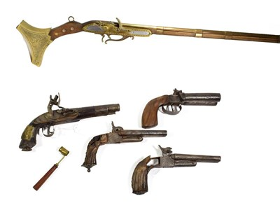 Lot 43 - ~ A Modern non-working copy of a jezail; a double barrel percussion pistol; two relic condition...