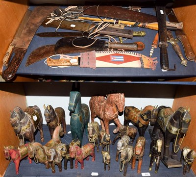 Lot 44 - ~ Two bill hooks, eleven machetes, two copy swords and a quantity of painted wood and other...