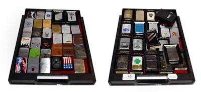 Lot 45 - ~ A collection of Zippo lighters including advertising and leather mounted examples (2 trays)