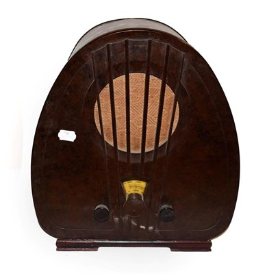 Lot 48 - ~ An Art Deco Philips valve radio in Bakelite case, 44.5cm