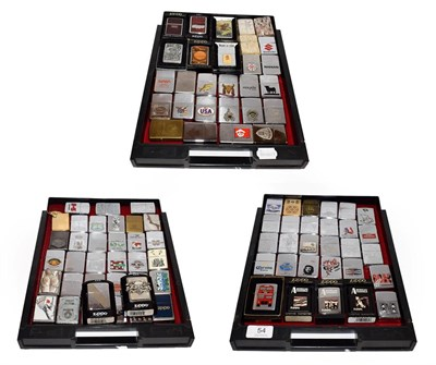 Lot 54 - ~ A collection of Zippo lighters including advertising examples (3 trays)