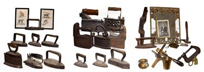Lot 55 - ~ A collection of metalwares, mainly flat irons and box irons, antique leather working tools...