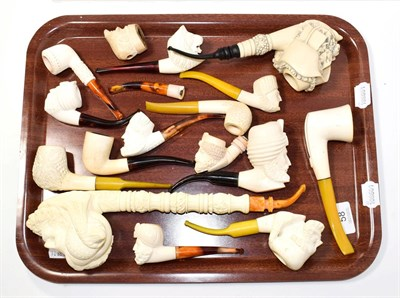 Lot 58 - ~ A collection of Meerschaum pipes, one large example elaborately formed as a Turk and also...