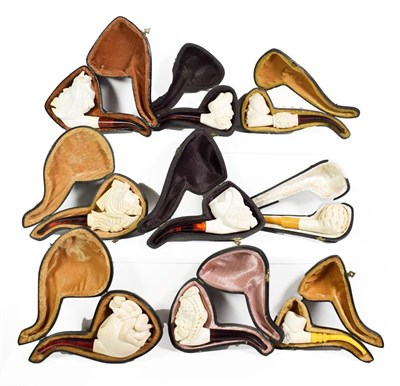Lot 61 - ~ A collection of Meerschaum pipes including an erotic example and others formed as Turks (1 tray)