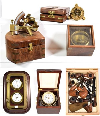 Lot 62 - ~ Reproduction marine instruments in cases including compasses, sextant and quartz ships clock,...