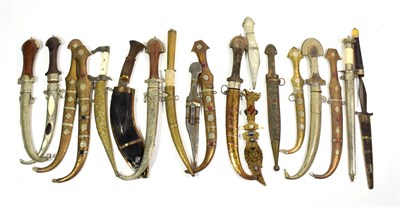 Lot 65 - ~ Assorted daggers and kinjhals in scabbards including metal mounted Indian examples, Gurkha...