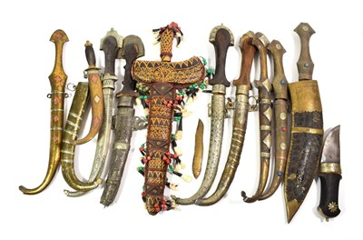 Lot 66 - ~ A collection of mainly Indian kinjhals and daggers including some with metal mounted scabbards; a