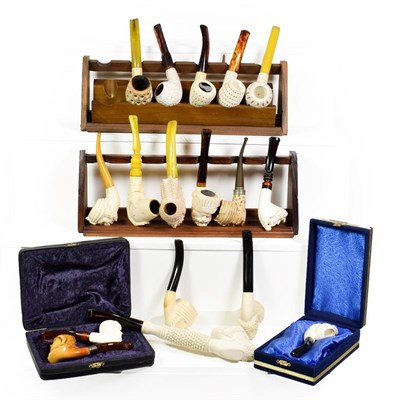 Lot 67 - ~ Two pipe racks and a quantity of Meerschaum pipes formed as Turks etc (1 tray)