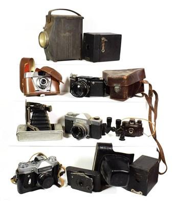 Lot 71 - ~ Vintage cameras including bellows cameras and a Bakelite model 35 spy camera, makers include...