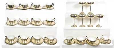 Lot 72 - ~ Fourteen Spanish silver coffee cups and saucers with opaque glass liners, stamped Baxeda 916/000.