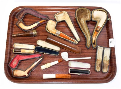 Lot 74 - ~ A collection of cased meerschaum pipes, cheroot holders and a figural clay pipe (1 tray)