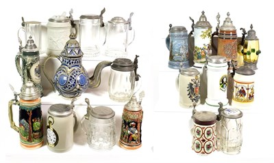 Lot 76 - ~ A collection of mainly German pewter lidded pottery and glass steins including an amber glass...