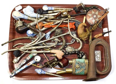 Lot 77 - ~ Assorted white metal pipes, copper bugle, flask and a Turkish style blue and white pottery coffee