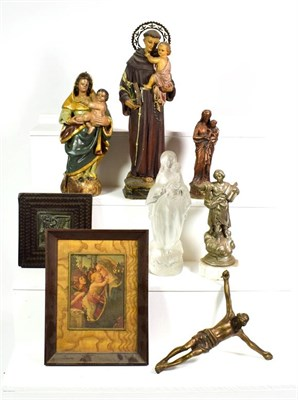 Lot 82 - ~ A leather bound Spanish bible with white metal mounts and a quantity of devotional statues...