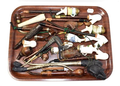 Lot 84 - ~ A collection of pipes including Bavarian examples with pottery bowls and two Cantonese...