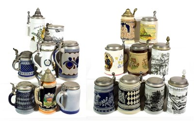 Lot 85 - ~ A collection of mainly German pottery steins with pewter mounts, including Westerwald salt glazed
