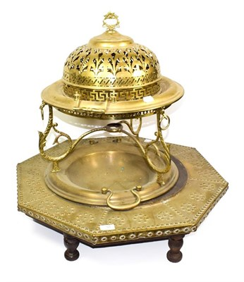 Lot 91 - ~ A Continental brass brazier with pierced domed cover and another of octagonal form with...