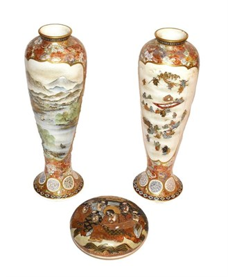 Lot 92 - ~ A pair of Japanese Meiji period slender Satsuma vases decorated with figure and landscape...