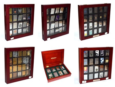Lot 95 - ~ Six collectors cases containing 105 Zippo lighters, including Elvis Presley, Beatles, Harley...
