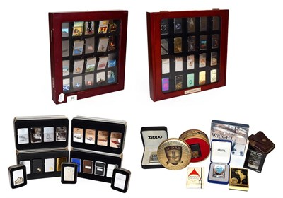 Lot 96 - ~ A quantity of Zippo lighters, some in collectors tins (2 display cases and 2 trays)