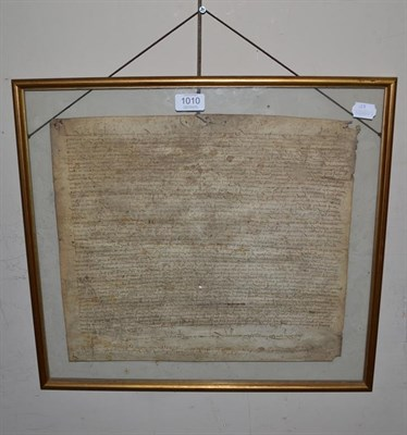 Lot 1010 - ~ A 16th century Spanish vellum document in gilt frame, inked on both sides and dated 1511,...