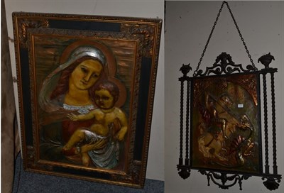 Lot 1011 - ~ Two relief polychrome plaques, one depicts the Virgin Mary and Child, the other St George and the