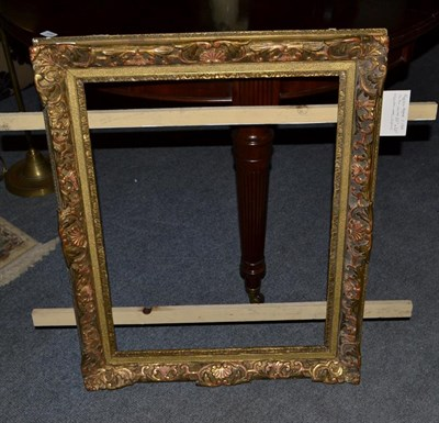 Lot 1077 - A giltwood picture frame circa 1900, overall 66cm by 82cm, aperture 64cm by 49cm