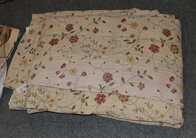 Lot 1089 - Woven sinuous floral curtains on cream, 230cm wide and 265cm drop, with blackout lining.