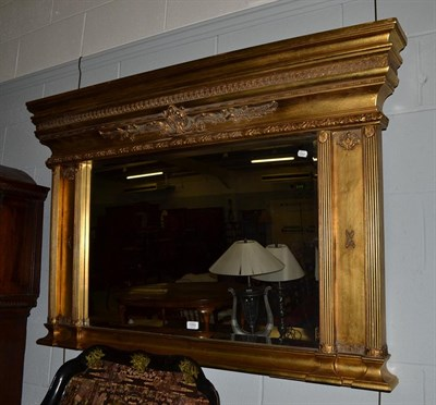Lot 1093 - A reproduction gilt framed over mantel mirror, 136cm by 91cm