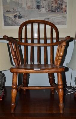 Lot 1095 - A child's elm Windsor armchair