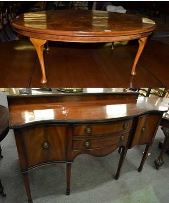 Lot 1098 - A reproduction oval inlaid quarter veneered walnut coffee table, 122cm by 86cm by 43cm,...