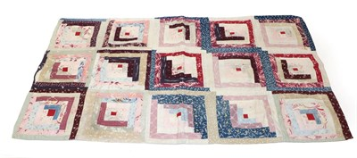 Lot 2020 - Late 19th Century Log Cabin Cot Quilt, the small red square to the centre depicts a fire in the log