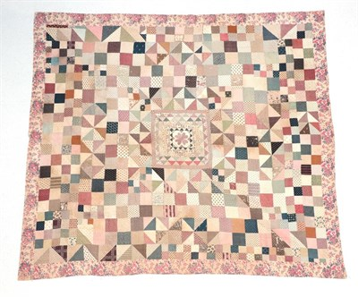 Lot 2021 - A Large 19th Century Patchwork Quilt, comprising a central square with small frames around a...